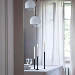comedor con candelabros de mesa Officina Magis