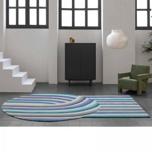 Ambiente alfombra Round Mirage Blue de Gan Rugs en Moises Showroom